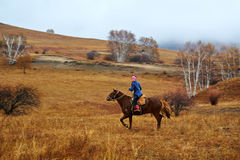 Women riding horse. The photo was taken in Wulanbutong Keshiketeng Banner Chifeng city Inner Mongolia Autonomous Region, China stock image
