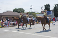 Women Riding Horses at Parade Stock Photography