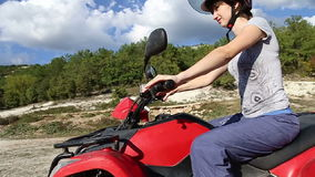 Women riding a quad bike. Happy stock footage