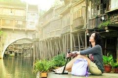 Women at riverside on the Phoenix Hong Bridge in Fenghuang stock photos