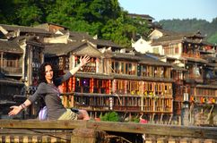 Women at riverside on the Phoenix Hong Bridge in Fenghuang royalty free stock images