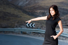 Women on the road. Young woman trying to take a tramp Royalty Free Stock Photo