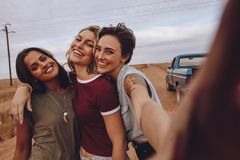 Women on road trip taking selfie stock images
