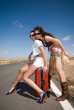 Women on the road waiting for a car Royalty Free Stock Photos