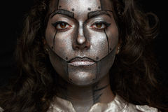 Women robot face. Close up of woman robot painted face isolated on black background stock photos
