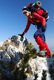 Women rock climbing in Romania mountaineering Royalty Free Stock Photo
