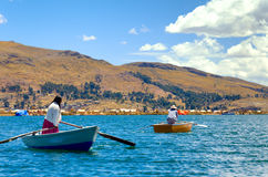 Women Rowing Boats Royalty Free Stock Image