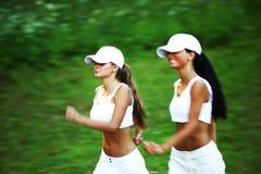 Women run Stock Image