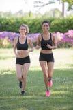Women run outdoors near sea Stock Images