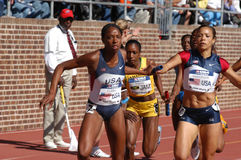 Women run in relay race. PHILADELPHIA, PA - APRIL 29: Hazel Clark takes handoff from Monica Hargrove on April 29, 2006. They are on the 800-meter anchor of the stock images