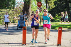 Women runners give thumbs up sign during 5K charity run Royalty Free Stock Photo