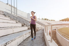 Women runners sprinting outdoors. Healthy lifestyle and sport co Stock Image