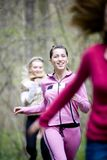 Women running. Three young women running together in forest, smiling Royalty Free Stock Photo