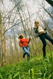 Women running. Young women running in forest, low angle view Royalty Free Stock Photo