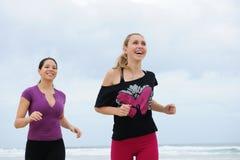 Women running on the beach Stock Photos