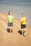 Women running on beach. Two women running and enjoying themselves on the beach Royalty Free Stock Photo