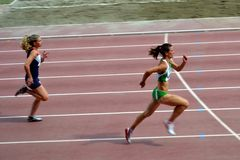 Women running in competition. Two athletes running in the Ridolfi Stadium in Florence, Italy, during the Quadrangolare città di Firenze on April 15th 2012 stock image