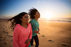 Women running. Couple of women running and walking on the beach Royalty Free Stock Photos