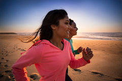 Women running. Couple of women running and walking on the beach Stock Photography