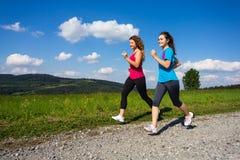 Women running, jumping outdoor Stock Photography