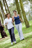 Women running outdoors Royalty Free Stock Images