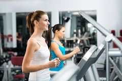 Women running on a treadmill Stock Image