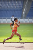 Women's 100 Meters for Disabled Persons. Image of Nguyen Thuy Thi (gold medallist) of Vietnam in action in the women's 100 meters for disabled persons race at Royalty Free Stock Images
