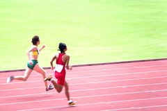 Women's 100 Meters for Visually Impaired Persons. Visually impaired athletes competing in a Women's 100 meters race Stock Photo