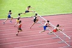Women's 100m Hurdles. Athletics event at stadium Stock Photo