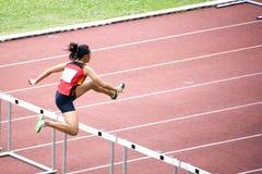 Women's 100m Hurdles. Athletics event at stadium Stock Images