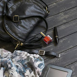 Women's accessories- black leather handbag, scarf, watch, nail Polish, mascara and tablet computer Stock Photo