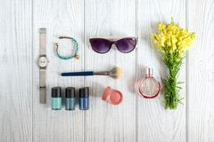 Women's accessories, cosmetics and wildflowers Stock Images