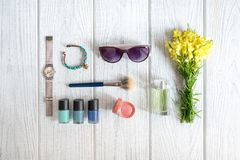 Women's accessories, cosmetics and wildflowers Royalty Free Stock Photography