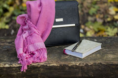 Women`s accessories - leather black bag, neckerchief and noteboo Royalty Free Stock Photography
