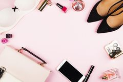 Women`s accessories - shoes, bag, cosmetics, perfume, phone on p. Ink background. Feminine and fashion background. Top view, copy space Stock Image