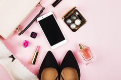 Women`s accessories - shoes, bag, cosmetics, perfume, phone on p. Ink background. Feminine and fashion background. Top view, copy space Stock Photos