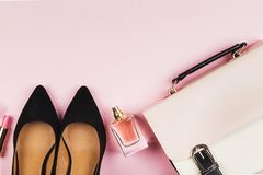 Women`s accessories - shoes, bag, cosmetics, perfume on pink bac. Kground. Feminine and fashion background. Top view, copy space Royalty Free Stock Images