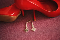 Women's Accessories. Shoes and earrings Stock Photo