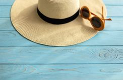 Women`s accessories - shoes, hat and sunglasses of orange color. Selective focus stock photos