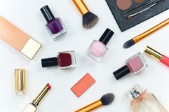 Women's accessories. Still life of fashion women. Scattered accessories: nail polish, perfume, lipstick, foundation. Overhead of essentials fashion woman objects Royalty Free Stock Image
