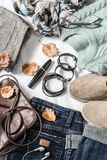 Women`s autumn outfit set of clothes and accessories - pullover, jeans, suede sneakers, skirt, leather bag with light background, Royalty Free Stock Photos