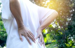 Women`s back pain outdoor while at work royalty free stock photo