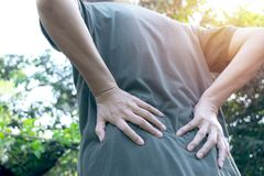 Women`s back pain outdoor while at work stock photography