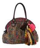 Women's bag. Colorful women's bag with tuft isolated on white Royalty Free Stock Image