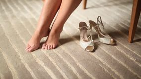 Women`s bare legs and shoes near them on the carpet. Wedding in stock video