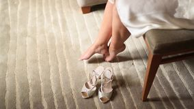 Women`s bare legs and shoes near them on the carpet. Wedding in stock footage