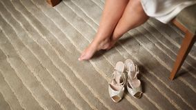 Women`s bare legs and shoes near them on the carpet. Wedding in stock video footage