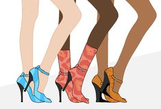 Women`s beautiful legs in shoes and boots Royalty Free Stock Image