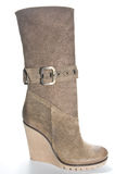 Women's beige suede boots on a high platform sole. Royalty Free Stock Photo