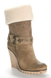 Women's beige suede boots on a high platform sole. 